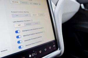 Tesla lane departure avoidance Settings