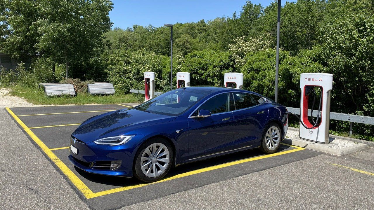 locate Tesla supercharger reduction of dc fast charging